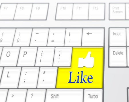 Keyboard with yellow Like button, social network concept Stock Photo - 10739611