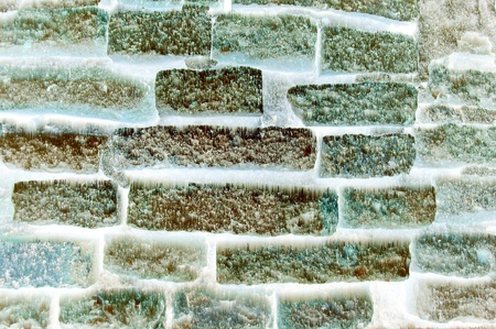 Ice on old brick wall background photo