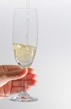 hand holding a Glass of Champagne photo