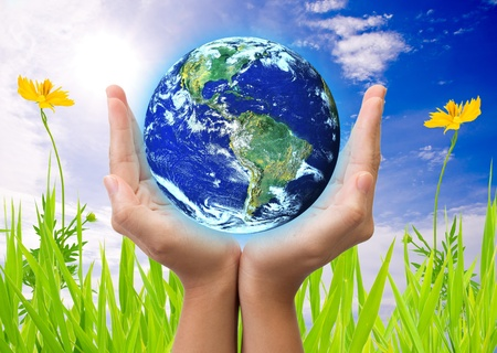 hand holding earth, saving earth concept. Earth globe image provided by NASA  Stock Photo
