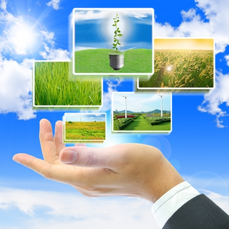 innovation concept: Business people holding the pictures with blue sky background