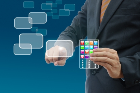 hightech: Businessman pushing the button and holding glass phone technology