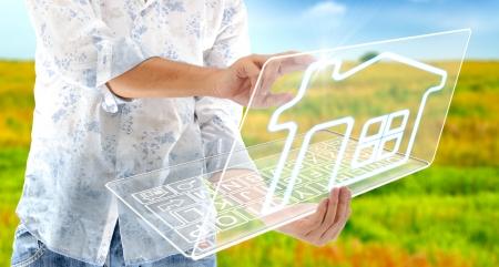virtual man: The man drawing house on laptop LCD display