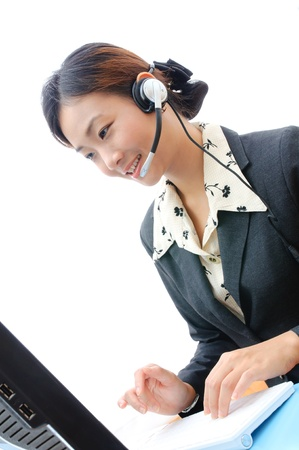Beautiful asia young business woman with headset and computer isolate on white background Stock Photo - 19730462