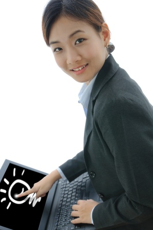 Young businesswoman drawing the lightbulb on laptop isolate on white background photo