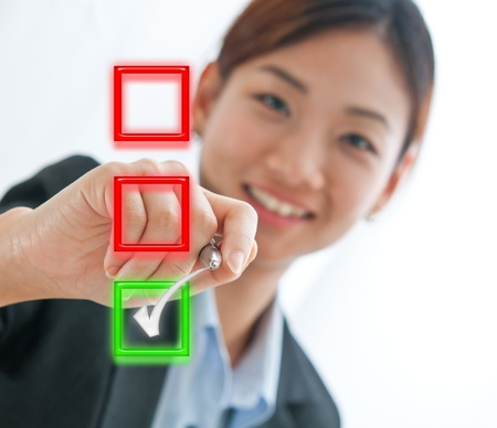 Businesswoman choosing mark the check box isolate on white background Stock Photo