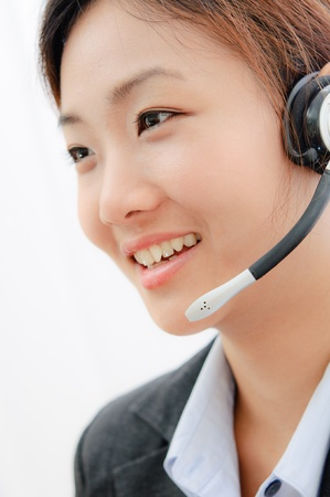 Beautiful asia young business woman with headset