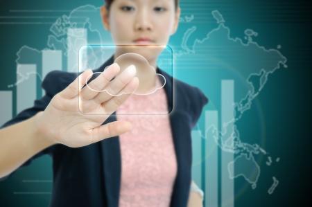 Businesswoman touch the virtual cloud button photo