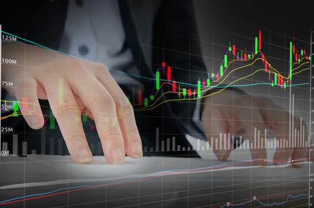 Bid: Bussinessman working hard on stock background Stock Photo