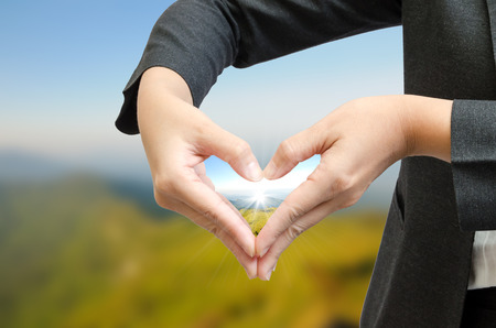 equitable: green world in the heart hand concept Stock Photo