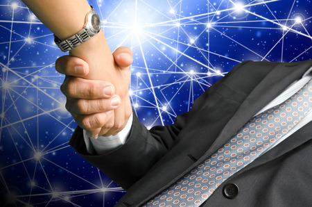 business people shaking hand on global business background photo