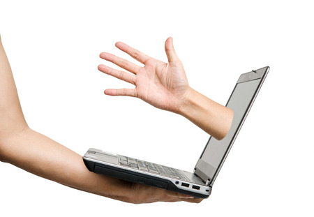 Hand holding laptop with request help hand, isolated on white background photo