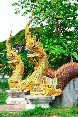 buddhist structures: statue king of nagas in front of Wat Phra Kaeo Don Tao in Lampang