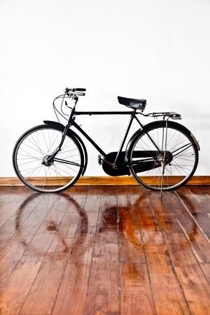 gossamer: Vintage bicycle on wood ground  Stock Photo