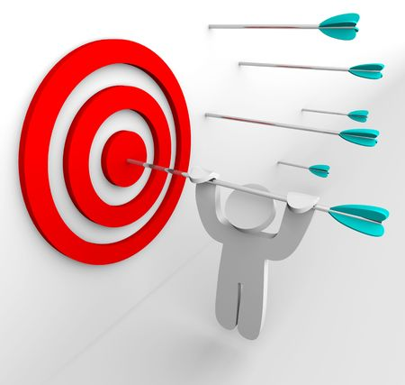 surpassing: A figure hangs from an arrow shot into a targets bullseye Stock Photo