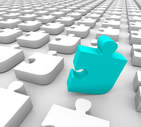 A blue puzzle piece stands out in a sea of white pieces Stock Photo - 4304649