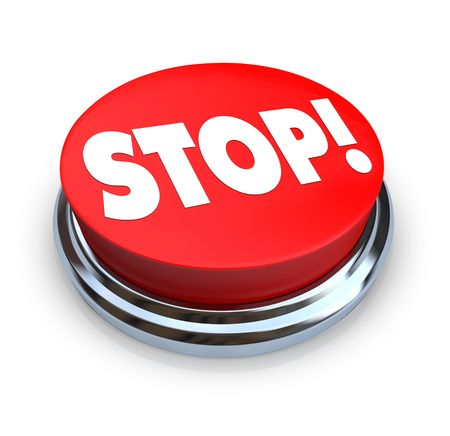 stoppage: A round button with the word Stop on it Stock Photo