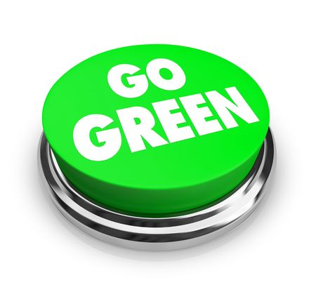 A button with the words Go Green on it, symbolizing the environmental movement photo