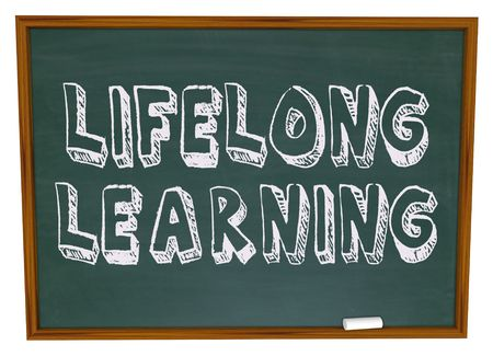 adults learning: The words Lifelong Learning on a chalkboard