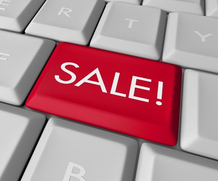 cheaper: A keyboard with a red key reading Sale Stock Photo