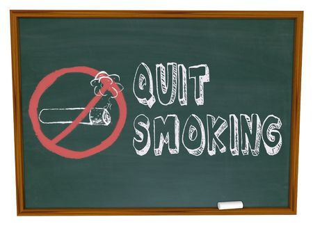 The words Quit Smoking written on a chalkboard with the no symbol over a cigarette