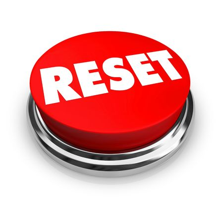 A red button with the word Reset on it photo