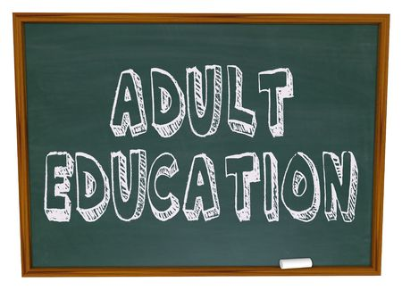 vocational: The words Adult Education written on a chalkboard Stock Photo