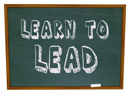 The words Learn to Lead written on a chalkboard Stock Photo - 4959959