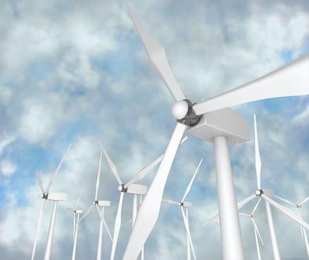 Several wind turbines against a blue cloudy sky Reklamní fotografie