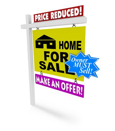 price reduction: A for sale sign with several additional markings on it representing the desperation of a seller