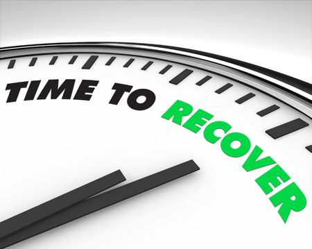 economic recovery: White clock with words Time to Recover on its face Stock Photo