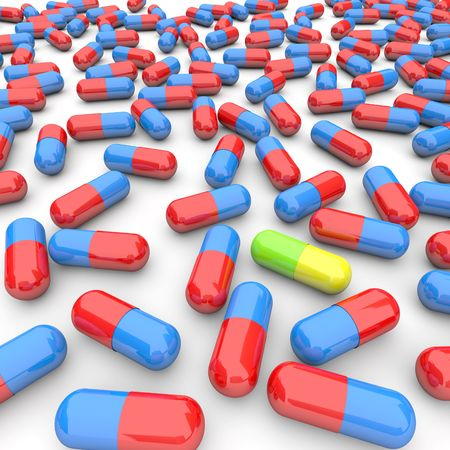 antidote: Many pills poured out onto a table, with one unique one standing out Stock Photo