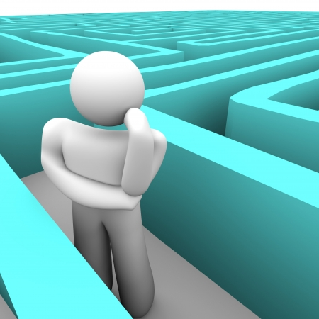 which: A person stuck in a maze trying to think of a way out Stock Photo