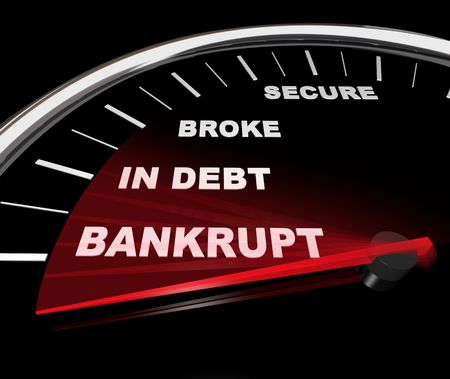 insolvent: A speedometer with needle plunging down past word Bankrupt Stock Photo