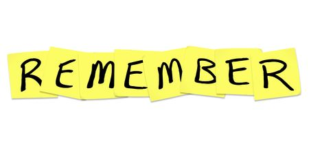 The word Remember written on yellow sticky notes Фото со стока