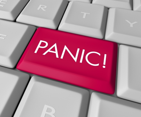 webserver: A keyboard with a red key reading Panic Stock Photo