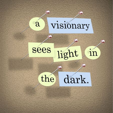 Pieces of paper each containing a word pinned to a cork board reading A Visionary Sees Light in the Dark. photo