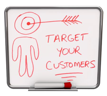dry erase: A white dry erase board with red marker, with the words Target Your Customers