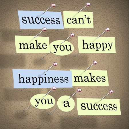 containing: Pieces of paper each containing a word pinned to a cork board reading Success Cant Make You Happy, Happiness Makes You a Success