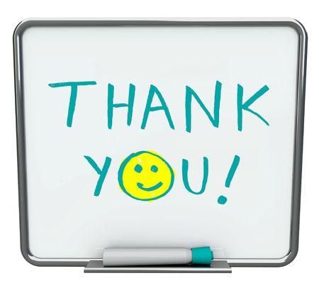 agradecimiento: Gracias escrita sobre un blanco seco borrar Junta con marcador azul Foto de archivo