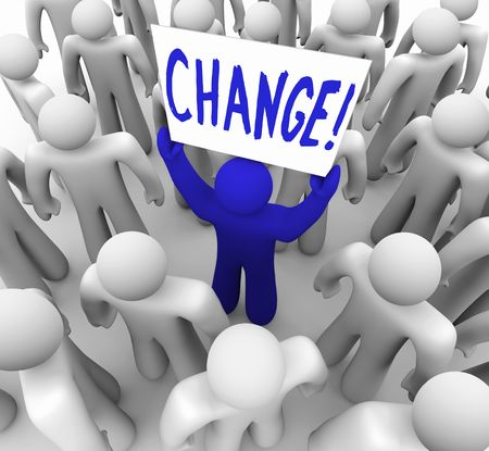 motivating: A blue person stands out in a crowd holding a sign reading Change Stock Photo