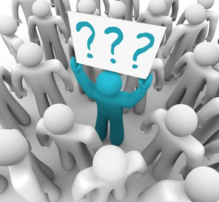 A blue person stands out in a crowd holding a sign with question marks on it Stock Photo - 6296741