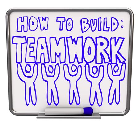 dry erase: A white dry erase board with blue marker, with the words How to Build Teamwork