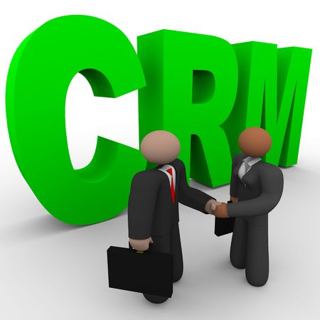 A business man and woman shake hands in front of the letters crm photo