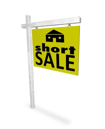 A sign with the words Short Sale and a picture of a home photo