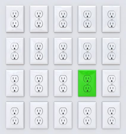 apart: A green power outlet stands apart from many white ones Stock Photo