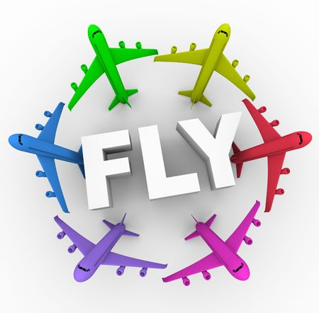Several apirplanes of different colors surrounding the word Fly Foto de archivo