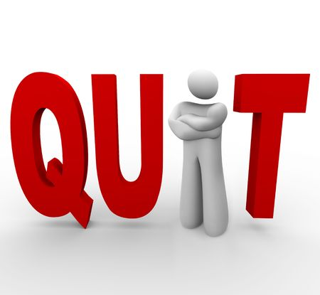resignation: A man stands in the word quit