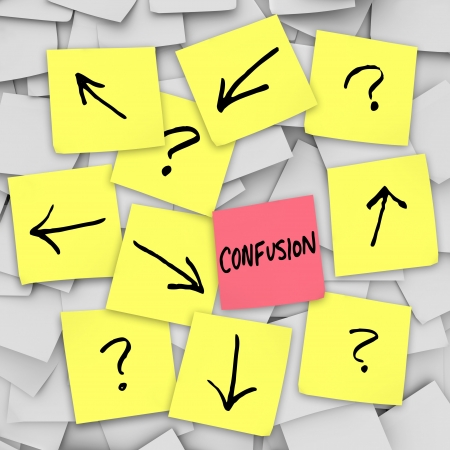 questions: Confusion - arrows and question marks on sticky notes Stock Photo