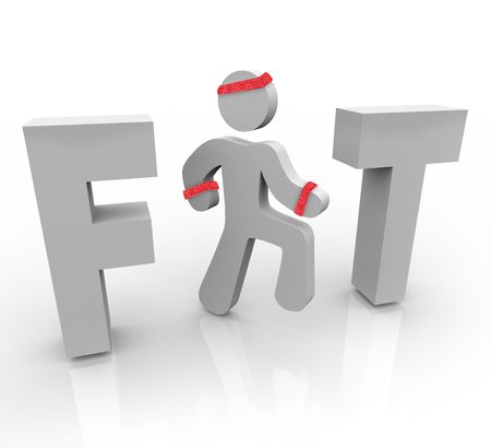 A jogging man stands in for the I in the word Fit Stock Photo